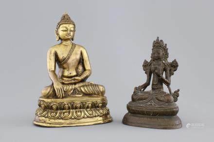 A Chinese gilt bronze seated buddha and a bronze Tara, 18/19th C.