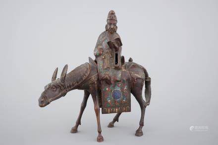 A Japanese champlevé enamel and bronze figure of a sage riding a donkey, 19th C.