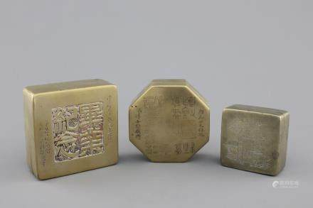 Three Chinese inscribed bronze seal boxes, 20th C.