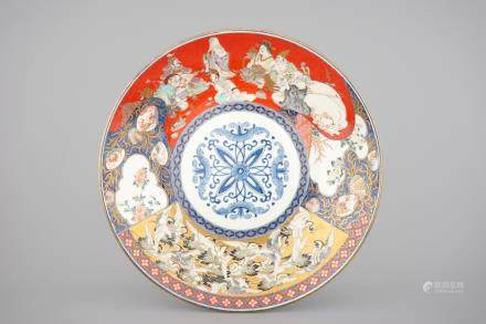 A large Japanese Koransha Fukagawa porcelain charger depicting the Seven Gods of Fortune and a swarm of cranes, late 19th C.