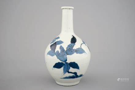 A Japanese arita bottle vase with blue floral decoration, 17/18th C.
