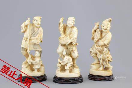 Three Japanese ivory carved okimono of fishermen with their son, Meiji, 19th C.