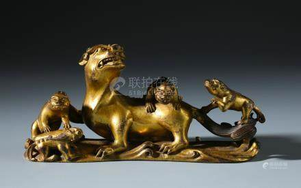 A Rare Chinese Carved Gilt Bronze Lion Brush Rest of