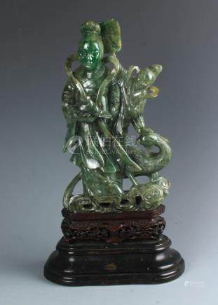 A Chinese Carved Jadeite Figure of Guanyin