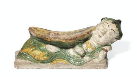 A CHINESE YELLOW AND GREEN-GLAZED POTTERY PILLOW