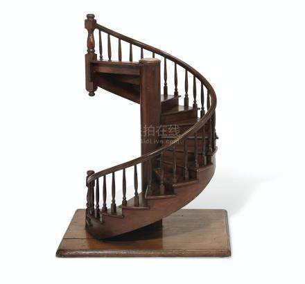 AN OVER-SCALE WALNUT MODEL OF A SPIRAL STAIRCASE