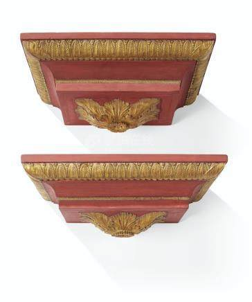 A PAIR OF NORTH EUROPEAN SCARLET AND PARCEL-GILT MASSIVE WALL BRACKETS
