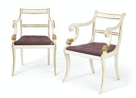 A PAIR OF REGENCY WHITE-PAINTED AND PARCEL-GILT ARMCHAIRS