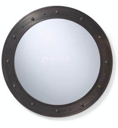 A PATINATED STEEL MIRROR