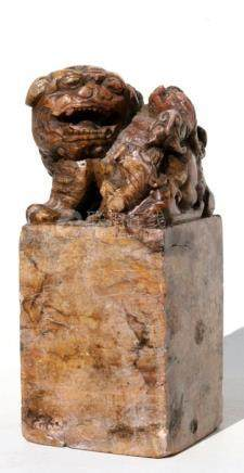 A large Chinese figured soapstone seal surmounted with a fo dog and its young, 24cms (9.5ins) high.