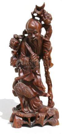 A Chinese rootwood carving in the form of Shoulau, 35.5cms (14ins) high.
