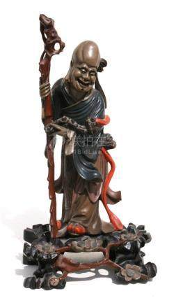 A Japanese Foo Chow lacquer figure of Shoulau, 34cms (13.25ins) high.