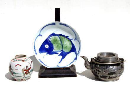 A Chinese pewter mounted Yixing pottery teapot; together with a Chinese crackle ware ginger jar