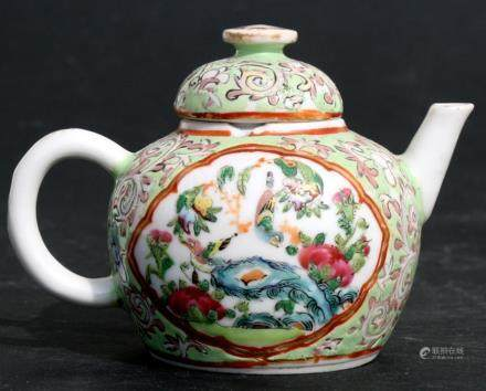 A Chinese miniature Canton famille rose teapot decorated with birds on a green ground, 7cms (2.