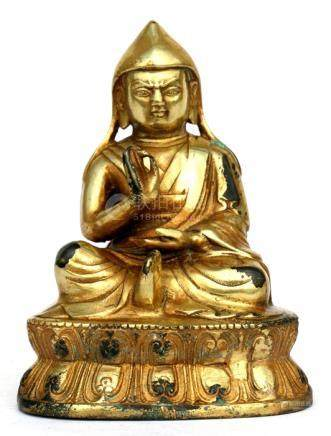 A Tibetan gilded bronze figure of a monk, 11cms (4.25ins) high.Condition ReportSome losses to gilded