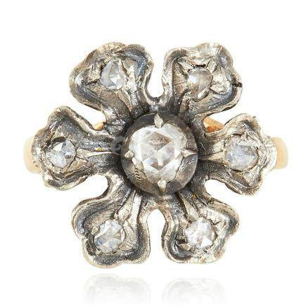 A DIAMOND RING in yellow gold, depicting a flower set