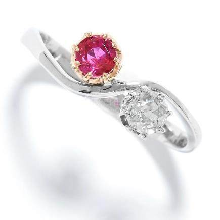 RUBY AND DIAMOND TOI ET MOI RING in platinum, set with