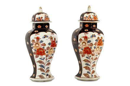 AN UNUSUAL PAIR OF JAPANESE IMARI VASES AND COVERS