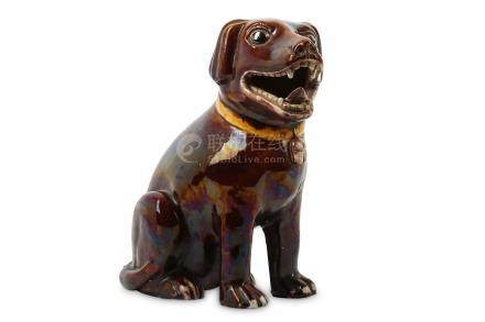 A CHINESE RED-GLAZED MODEL OF A DOG.