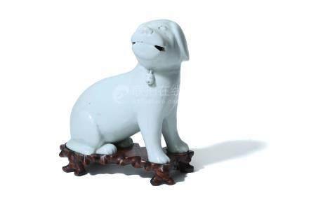 A WHITE GLAZED FIGURE OF A DOG.