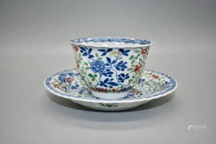 A fine polychrome enamel tea cup and saucer