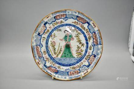 A fine and rare polychrome enamel dish depicting a figure in