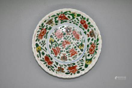 A charming famile vert dish depicting birds and flowers