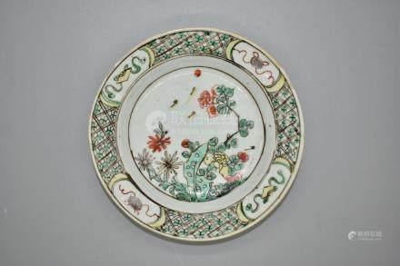 A famile vert dish depicing a garden scene