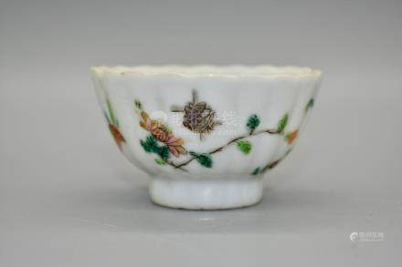 A small polychrome enamel foliate tea cup depicting insects