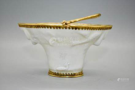 An interesting blanc-de-chine libation cup depicting dragons