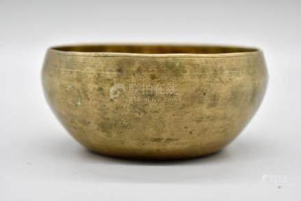 A gilt-bronze alms bowl