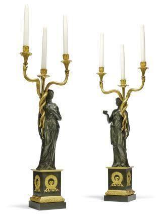 A PAIR OF EMPIRE ORMOLU AND PATINATED-BRONZE THREE-LIGHT CANDELABRA