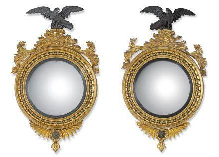 A PAIR OF REGENCY GILTWOOD CONVEX MIRRORS