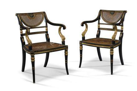 A PAIR OF REGENCY PARCEL-GILT AND EBONISED OPEN ARMCHAIRS