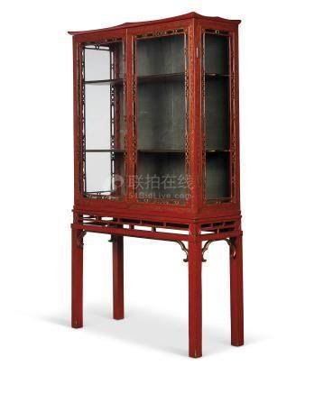 AN ENGLISH SCARLET AND GILT-JAPANNED DISPLAY CABINET