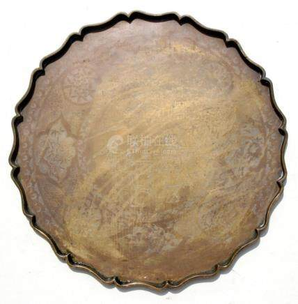 A Chinese bronze tray decorated with figures within a foliate border, 55cms (21.5ins) diameter.