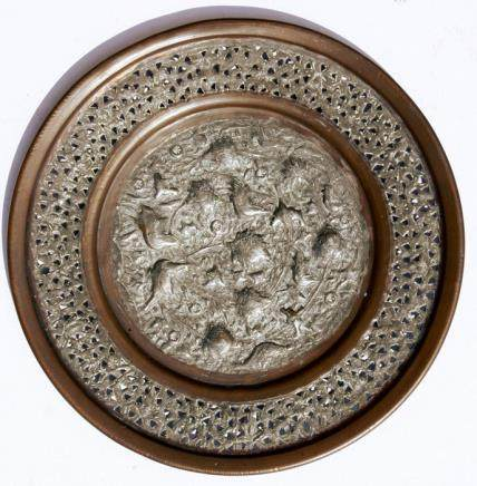 A 19th century Persian tinned copper charger decorated with birds and foliage within a pierced