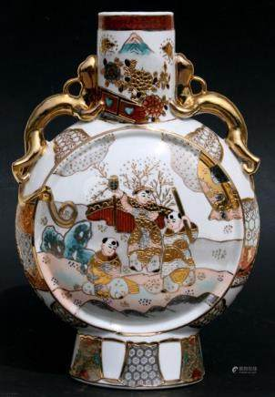 A Japanese porcelain moon flask decorated with figures, with dragon handles, 36cms (14ins) high.
