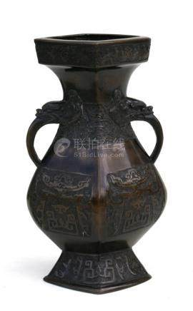 A Chinese bronze two-handled vase with archaic style decoration and impressed mark to underside,