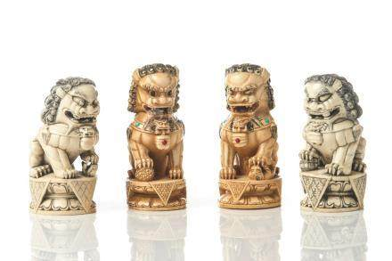 TWO PAIRS OF CHINESE NATURAL CARVED GUARDIAN LIONS