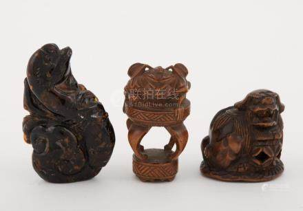 Two Japanese Boxwood Netsuke; Together with a Japanese Amber