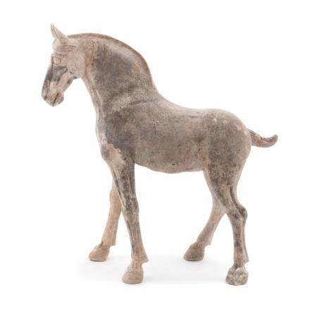 A Pottery Figure of a Horse Height 16 in., 41 cm.