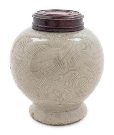 A Celadon Glazed Porcelain Incised Jar Height 4 3/4 in., 12