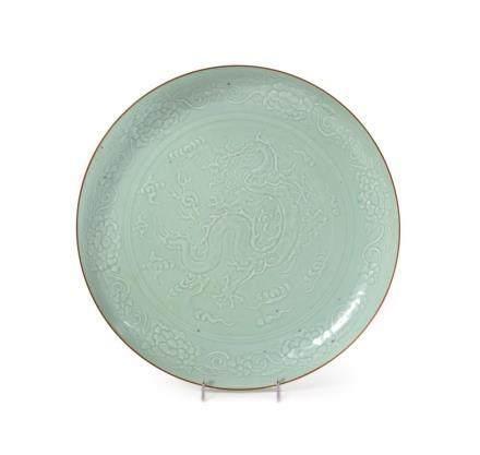 A Large Carved Celadon Glazed Porcelain Charger Diam 16 in.,