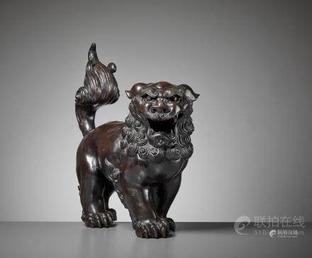 A VERY LARGE BUDDHIST LION BRONZE, MING