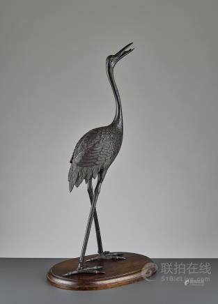 A RARE BRONZE OF A RED-CROWNED CRANE, LATE MING