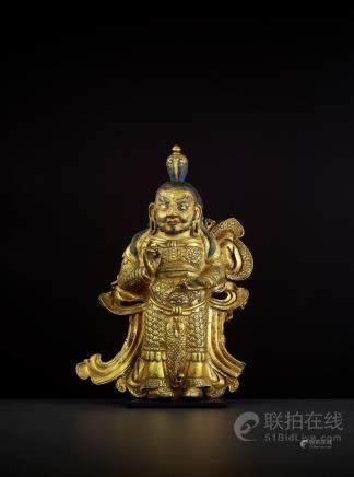 A GILT COPPER GUARDIAN KING, TIBET 17TH CENTURY