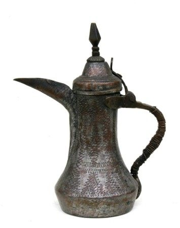 A Turkish / Islamic tinned copper dallah coffee pot, 26csm (10.25ins) high.