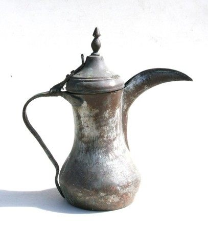 A large Turkish/Islamic tinned copper dallah coffee pot. 38cm (15 ins) high