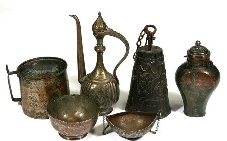 A group of Persian or Islamic items to include a camel bell, kashkul bowl & ewer (6).
